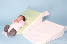 The reflux or colic  baby can be positioned at the bottom of the wedge in a reclined position or move the harness to the middle of the wedge so that the baby can be placed supine (flat on its back) at a 30 degree or 15 degree angle.  The baby can be placed prone (on its tummy) with the headring removed but must be supervised, good for tummy time see our instructions tab for video on positioning.