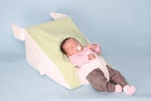 The reflux or colic  baby can be positioned at the bottom of the wedge in a reclined position or move the harness to the middle of the wedge so that the baby can be placed supine (flat on its back) at a 30 degree.  The baby can be placed prone (on its tummy) with the headring removed but must be supervised, good for tummy time see our instructions tab for video on positioning.