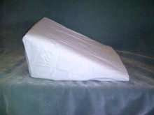 zip on off wedge cover 100% whirte cotton.  This is different from the wedge cotton sheet.