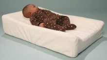 Our Elevated Changing Station is unique.  It is filled with plant based formed foam rubber to comfortably elevate baby to avoid spit up and it is covered in velvet soft waterproof terrycloth for easy cleaning. The waterproof terrycloth cover zips off for easy washing. Machine wash gentle cold, line dry.  The bottom of the changing station is non-skid rubber material to avoid slipping on surfaces. Product Dimensions: 28ins L x 16ins w x 7 inches high on elevated side